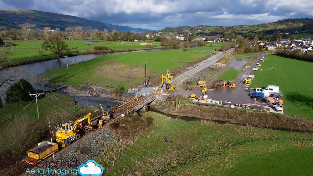 Aerial photo of emergency rail repairs, Llanrwst, Conwy