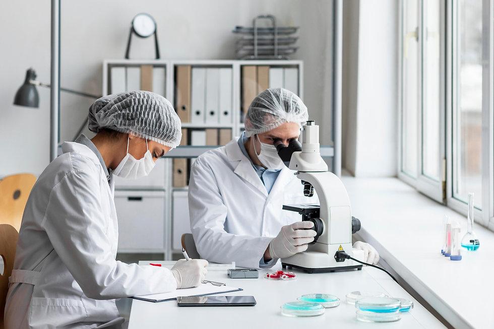 medium-shot-scientists-laboratory.jpg
