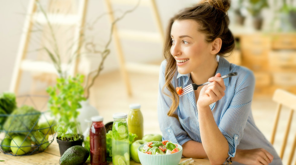 Young-happy-woman-eating-healthy-salad-h