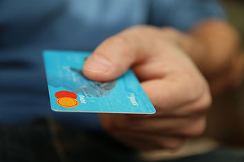 Man holding a credit card in his hand.
