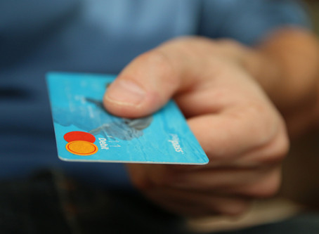 How does a secured credit card help you?