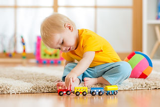 child boy playing with toys indoors at h