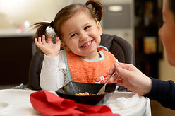 cute little girl eating.jpg