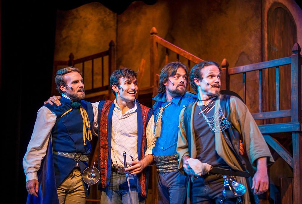 Zachary Scovel as Aramis, Brian Bohlender as D'Artagnan, Dylan Michael Collins as Porthos, and Ian Hopps as Athos