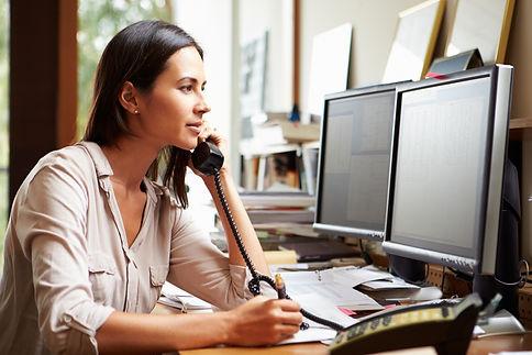 Lady on phone at desk.jpg