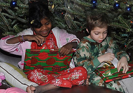 kids-open-christmas-gifts-diane-lent.jpg