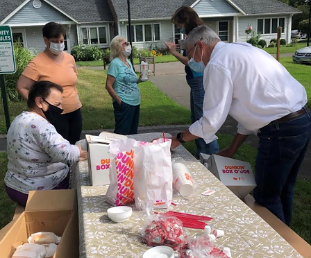 In The News | Bob For State Rep | Bob Serving Breakfast at Ballard Green during Isias