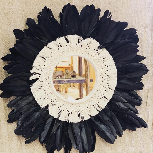 Macramé mirror with feathers