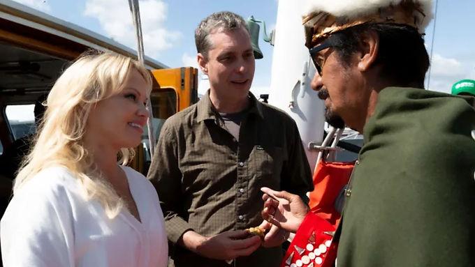 Activists release footage as Pamela Anderson boards fish farm