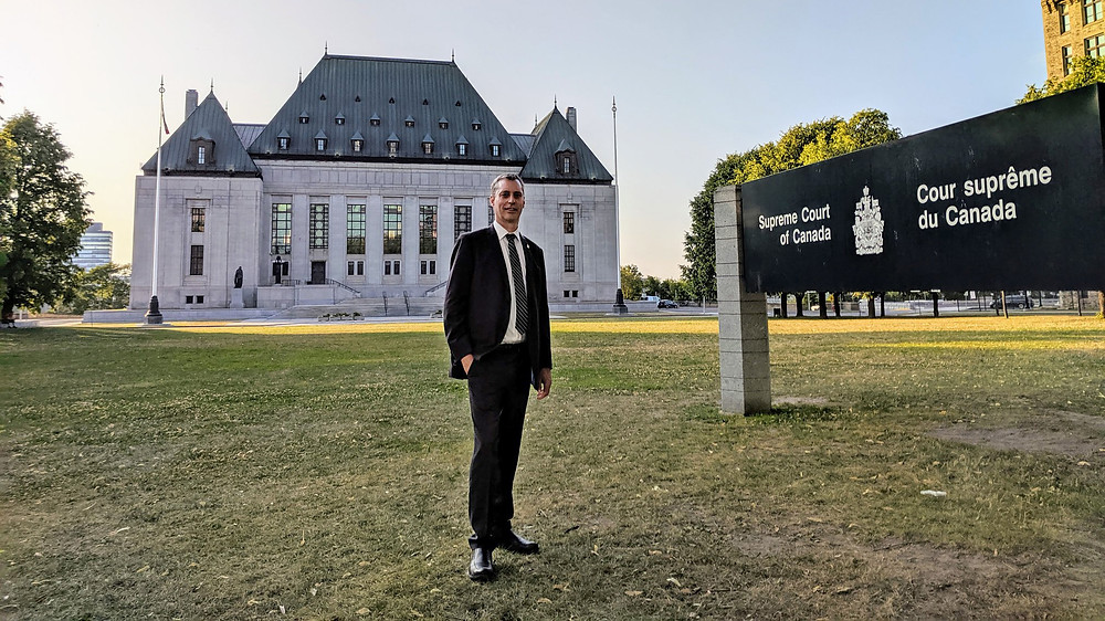 Green Party MP Paul Manly stands in front of the Supreme Court of Canada