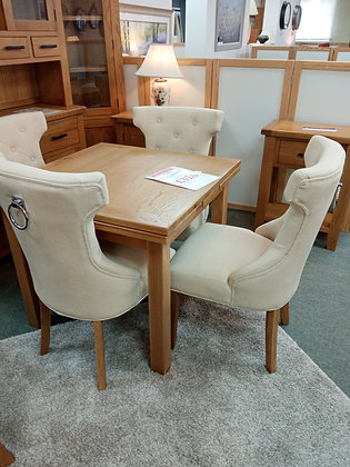 Set of 4 Knocker Back Chairs in a Cream Fabric with Medium Oak Legs