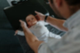 A baby or child being adjusted by a chiropracto in South Burlington Vermont