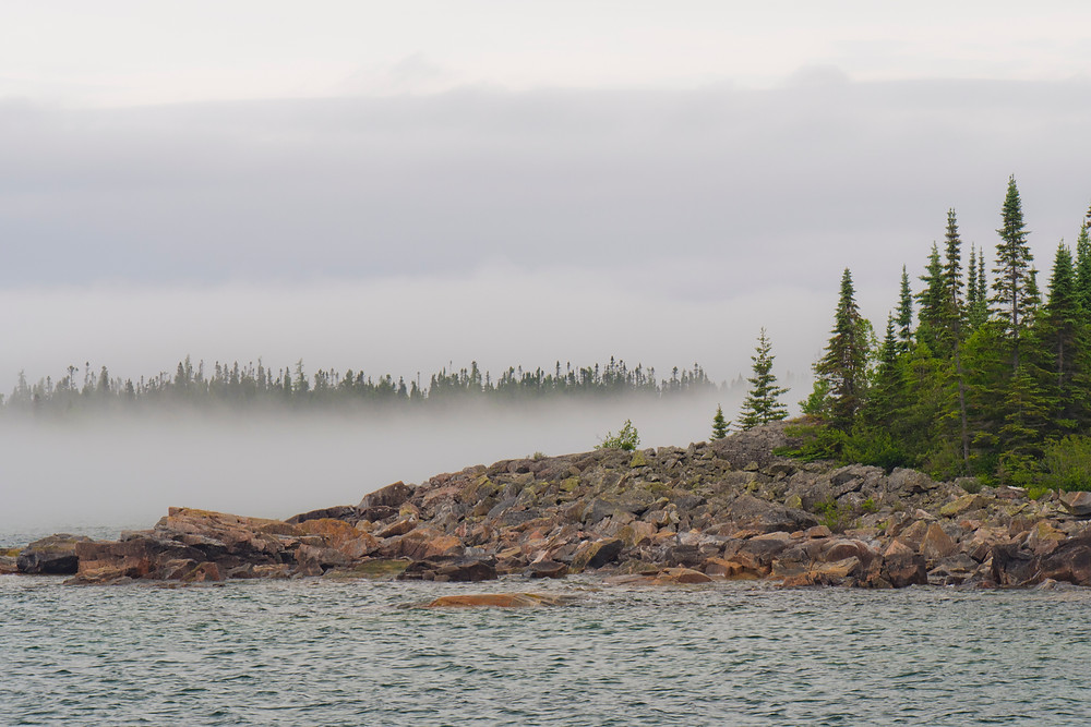 Fog clings to the Superior shore.