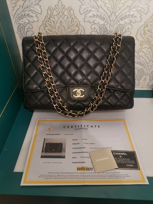 Excellent condition Chanel Maxi Classic Single Flap Black Caviar with GHW