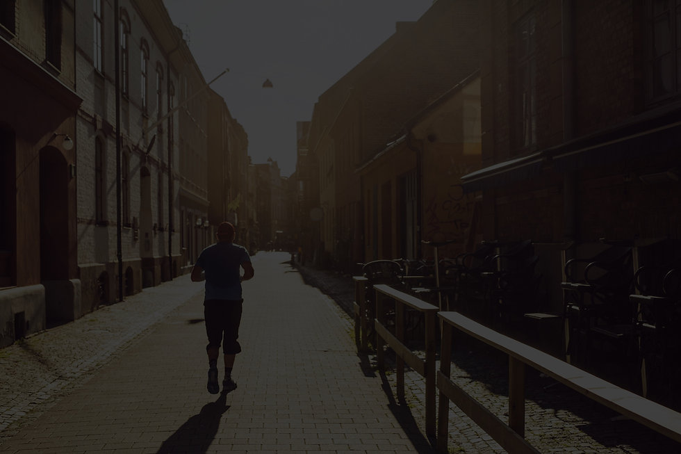 man-running-in-old-town-N9DAGLY_edited.j