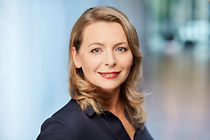 Photo of Agnieszka Gapys, set against a blurred background.