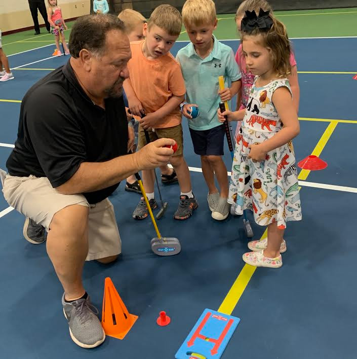 Pictured is Bill Barrows with First Tee Golf Participants