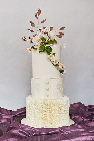 Ivory wedding cake, ruffles, sugar flowe