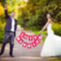 Couple with red and white just married sign