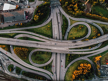 aerial-shot-of-twisted-roads-surrounded-