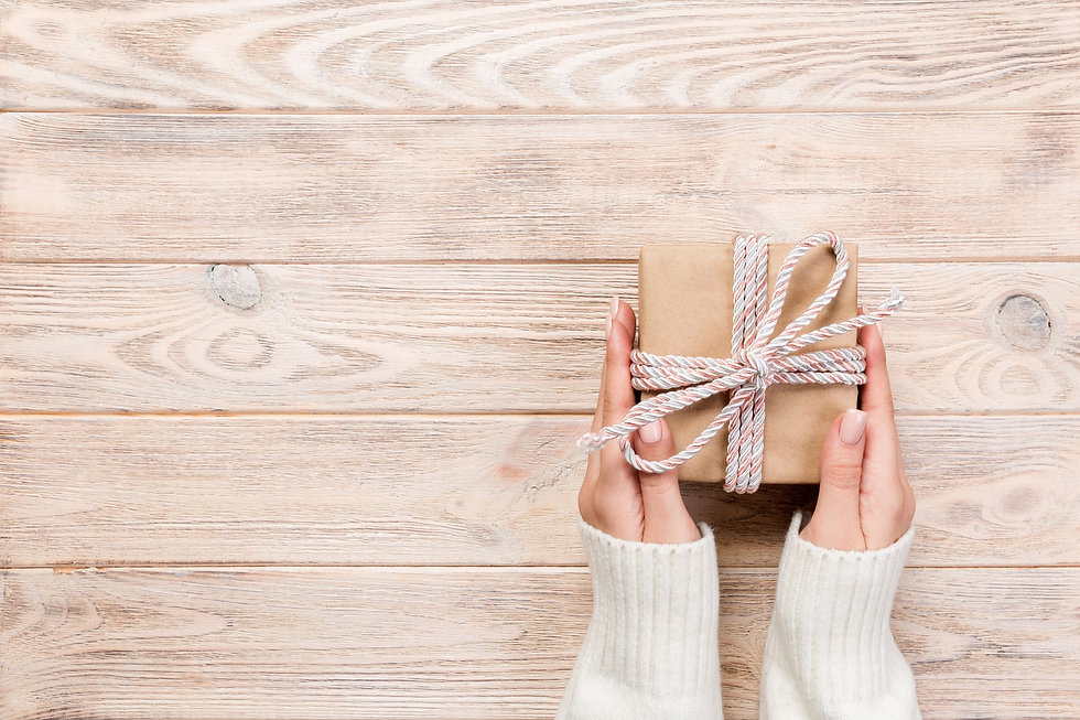 woman-hands-give-wrapped-valentine-paper
