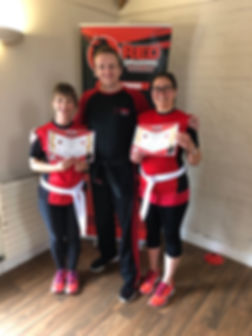 Some of our Red Dragons Ladies receiving their new belts