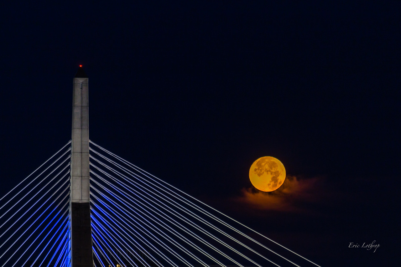 Full moon setting over the Zakim Bridge in Boston