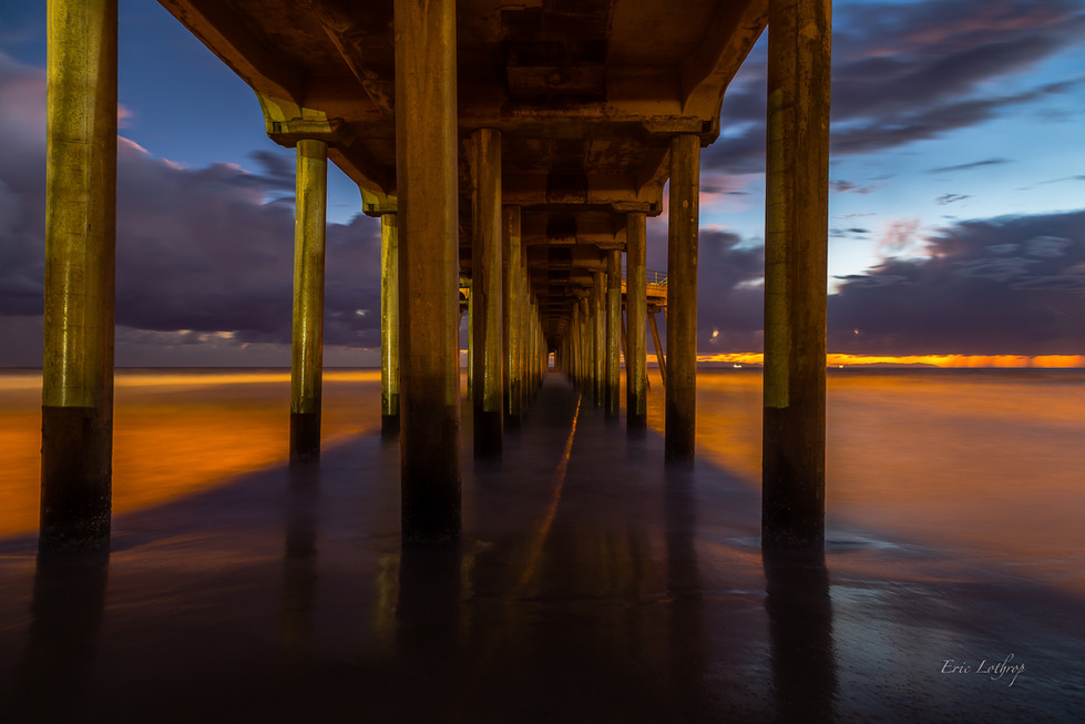 Underneath The Boardwalk At Sunset
