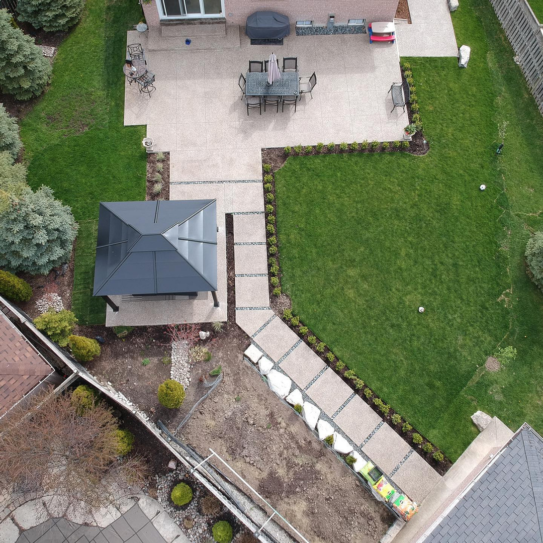Backyard patio and walkway in Exposed Aggregate