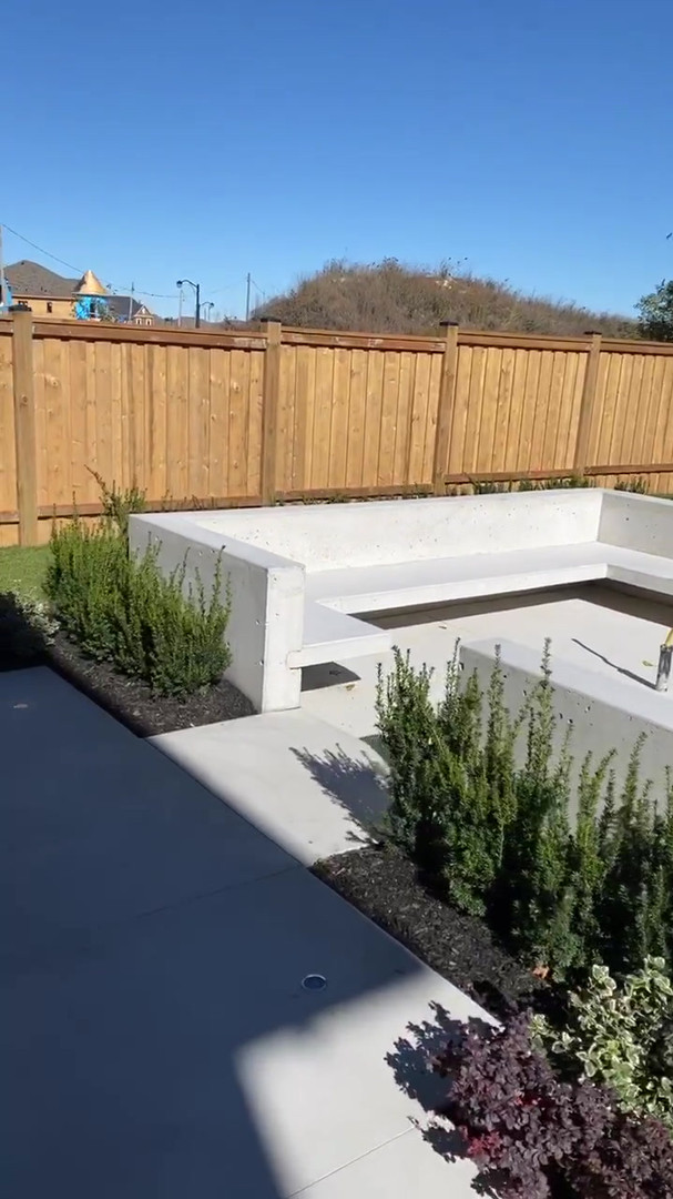 Custom Concrete Firepit and Limestone Finish Backyard