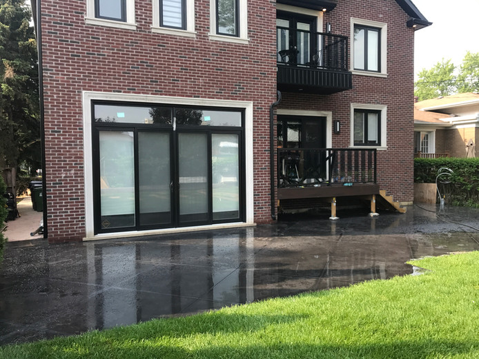 Black backyard concrete patio with Diamond cuts