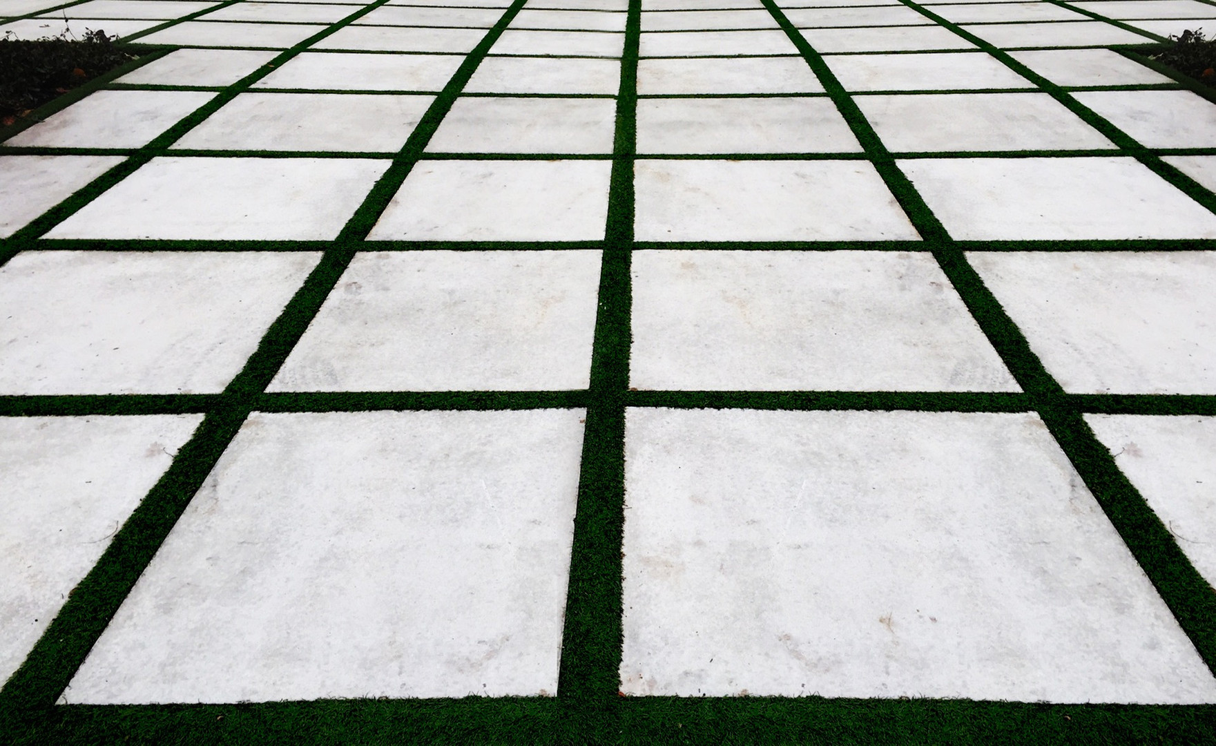 Concrete stepping slabs with artifical grass