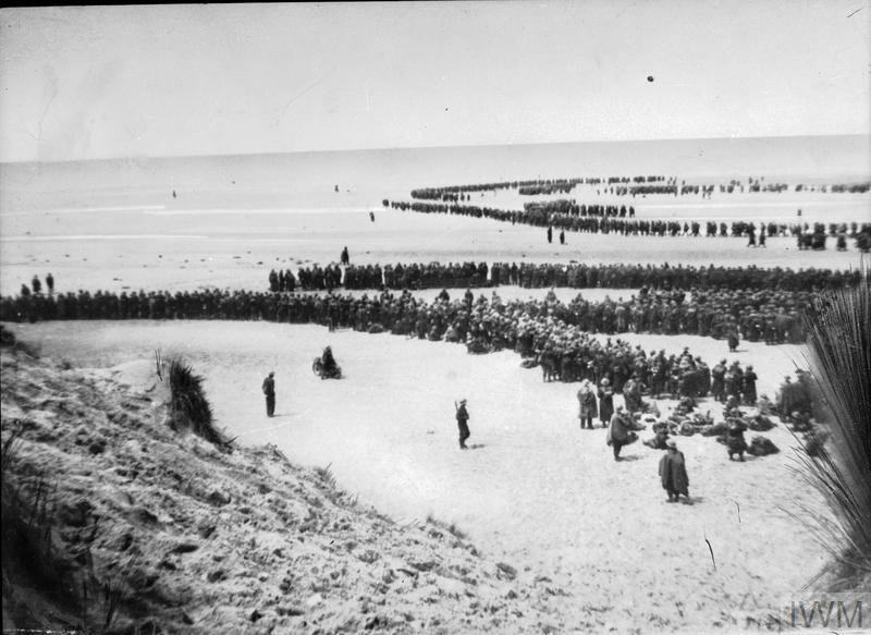 British troops line up on the beach at Dunkirk in 1940 to await evacuation