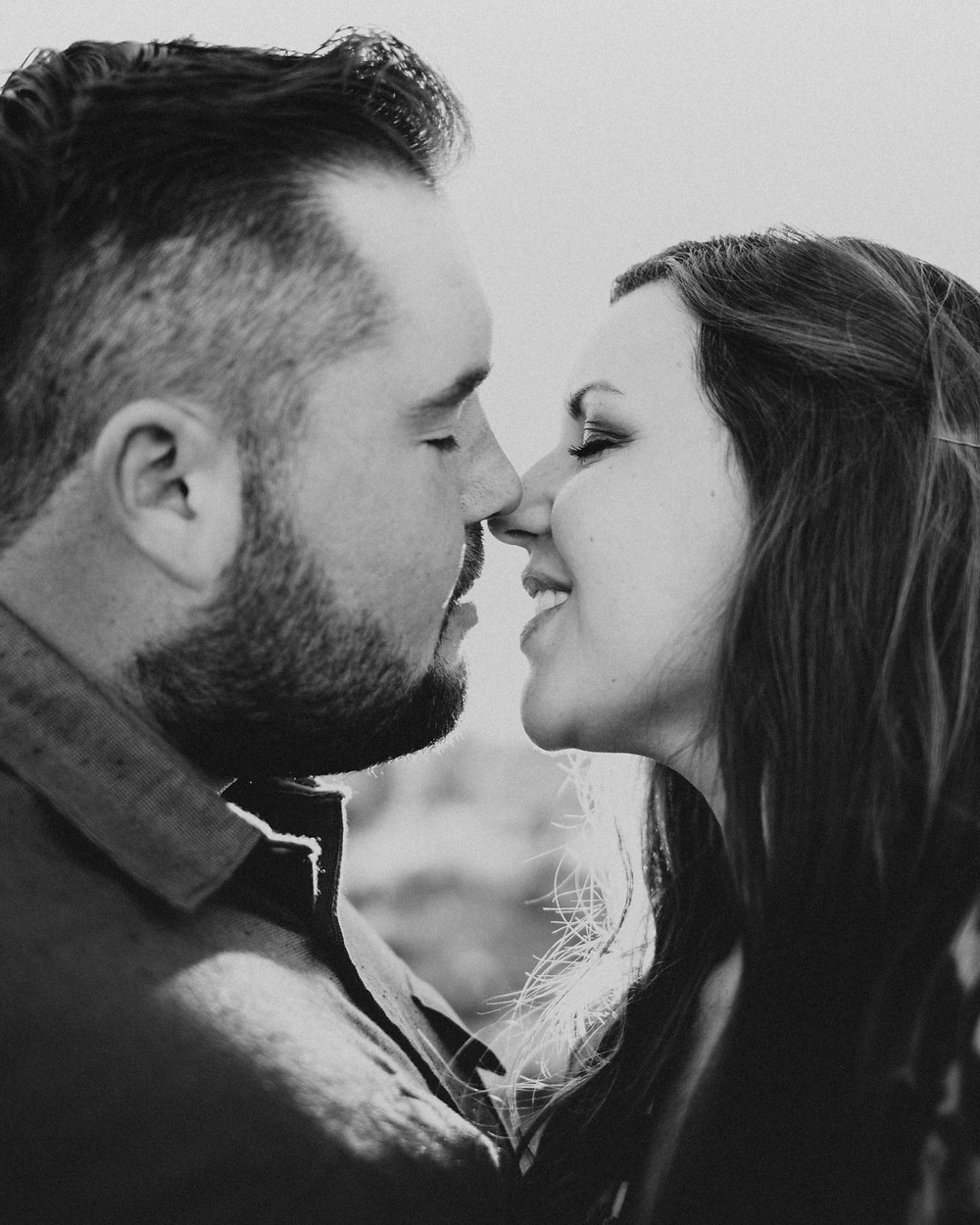 black and white photograph of a couple almost kissing captured by las vegas wedding photographer hayway films
