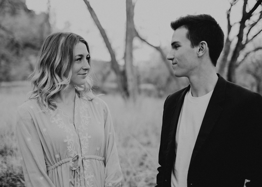 black and white capture of engaged couple smiling at each other during their zion national park engagement photos