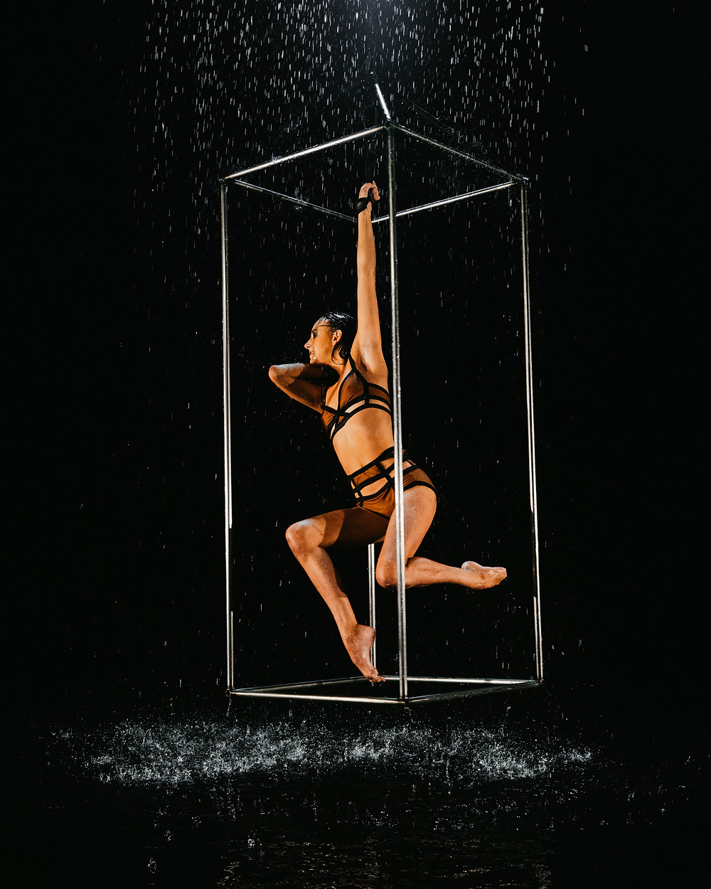 cirque du soliel performed hangs upside down doing the splits captured by Las Vegas videographer hayway films in the rain