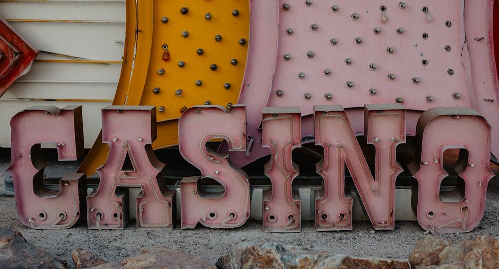 Casino vintage neon sign. Neon Boneyard in Las Vegas Nevada, colorful vintage neon signs arranged, captured by las vegas elopement photographer hayway films.