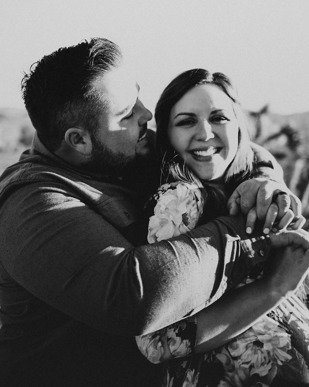 A black and white photograph of couple laughing and almost kissing. las vegas wedding photographer
