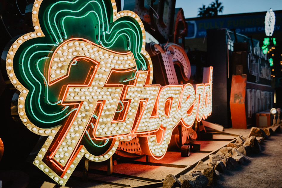 Fitzgerald neon sign Neon Boneyard in Las Vegas Nevada, colorful vintage neon signs arranged, captured by las vegas elopement photographer hayway films.