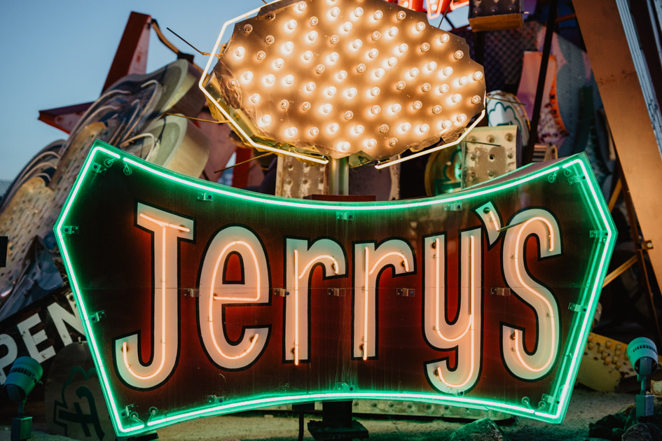 Jerry's red and yellow neon sign at Neon Boneyard in Las Vegas Nevada, colorful vintage neon signs arranged, captured by las vegas elopement photographer hayway films.