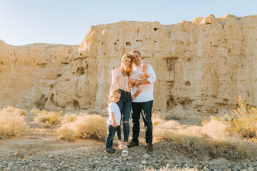 Family in the desert smiling, captured by las vegas family photographer in tule springs fossil beds