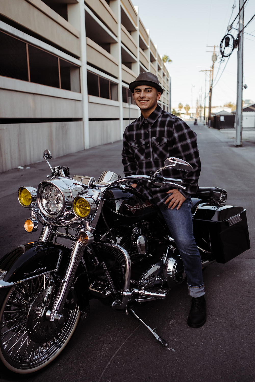 High school senior poses on harley motorcycle for vintage downtown senior portraits in las vegas
