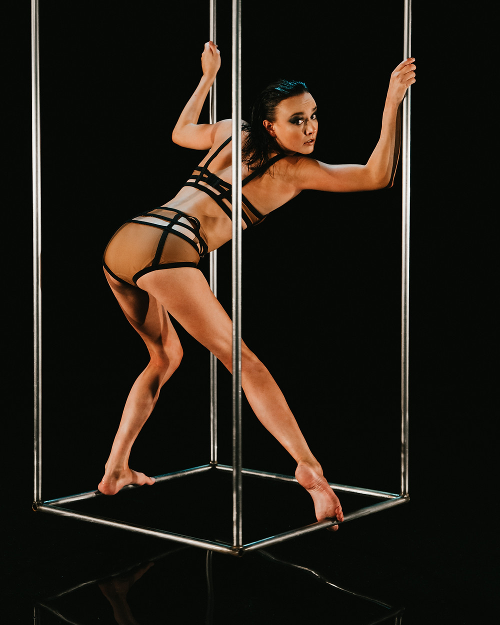 circus performer hanging in silver box captured by Las Vegas photographer hayway films