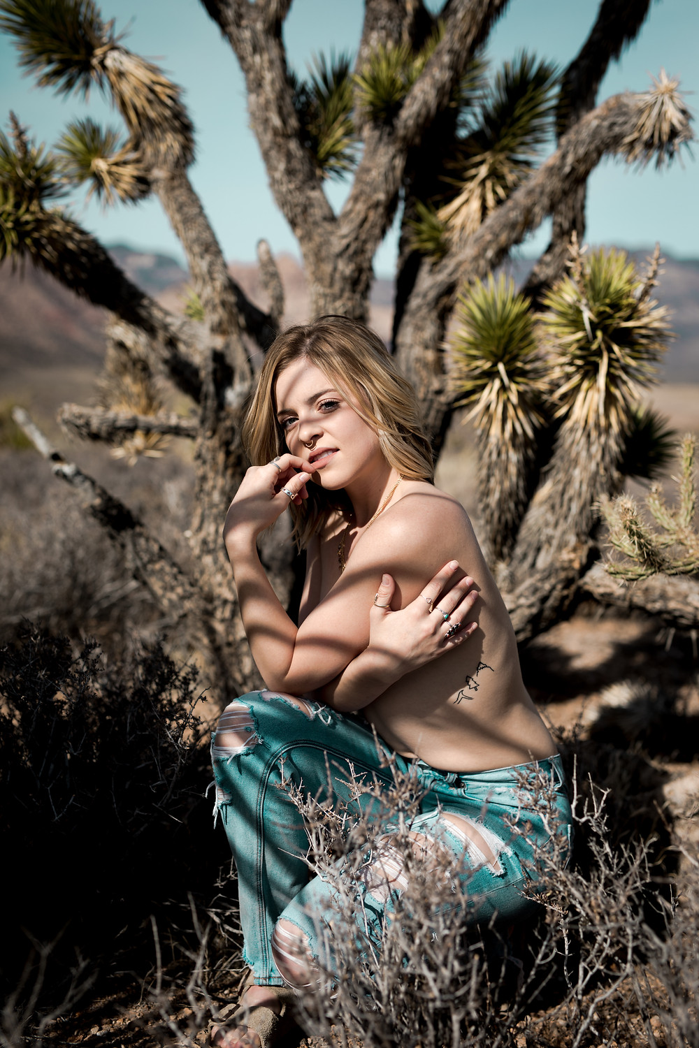 topless women posing in the desert, surrounded by joshua trees, wering only vintage levis, captured by boudoir photographer in las vegas hayway films