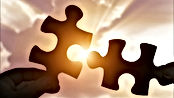 Puzzles pieces being connected in sun - Silhouette - Click to link to WHUT matching gifts page