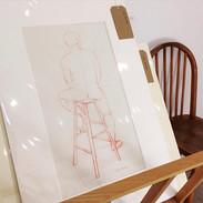 Man on a stool