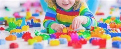 girl-playing-with-colorful-blocks_edited_edited.jpg