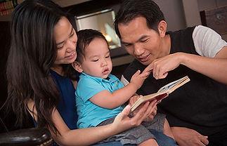 mom-dad-reading-child.jpg