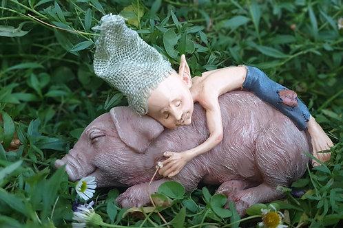 Pixie sleeping on a pig