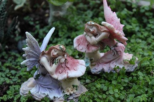 Resting fairy on mushroom